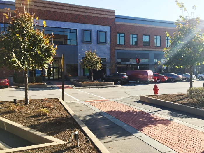 Randhurst Village was designed to accommodate pedestrians and motorists with variegated paving and landscaping for pedestrians and angled parking for motorists.