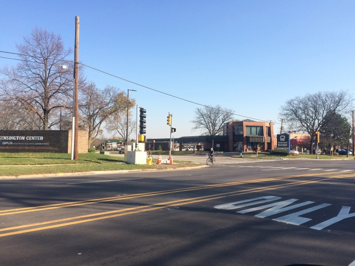 This plan will study circulation patterns, including access to nearby activity centers (such as this left turn only lane leading into the Kensington business Center at Rand Road and Business Center Drive).