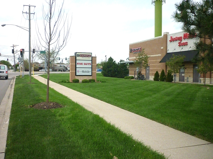 Businesses along the Rand Road corridor benefit from high visibility with rear facades, but are challenged by low accessibility of complicated roadway circulation patterns.